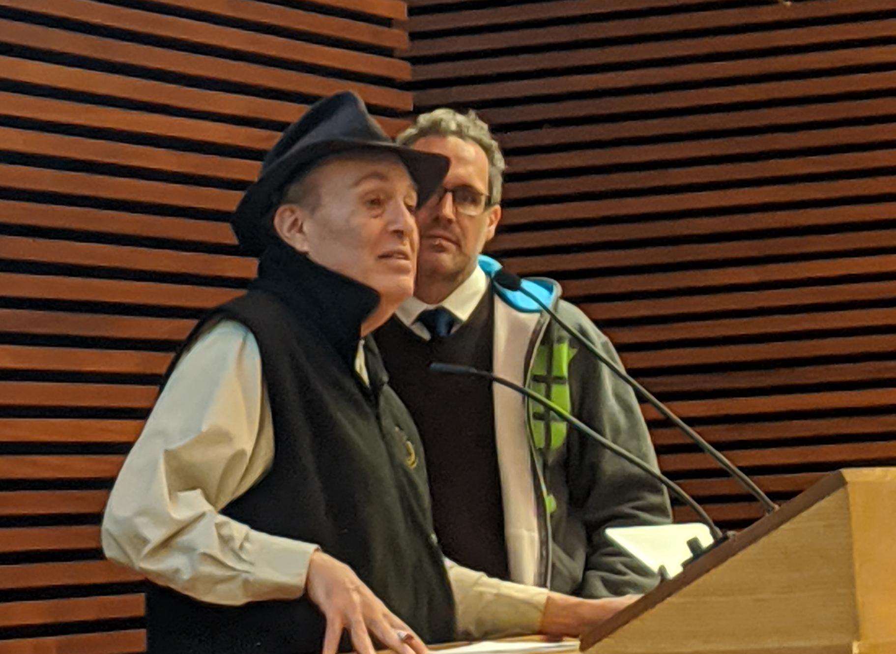 Richard B. Freeman and Rafael Gomez stand at a podium