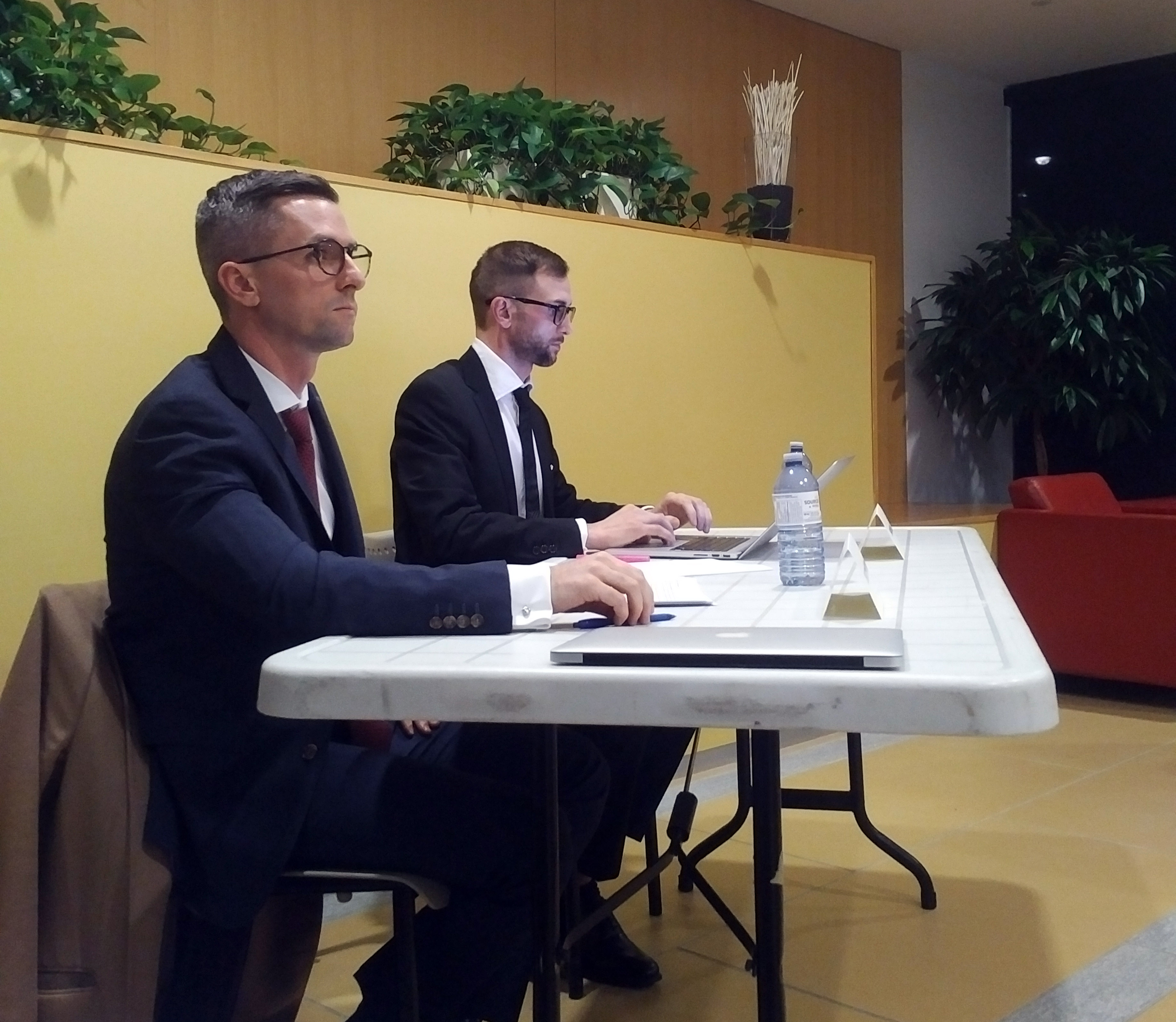 Shawn Meikle and Christopher Sider sit at a table