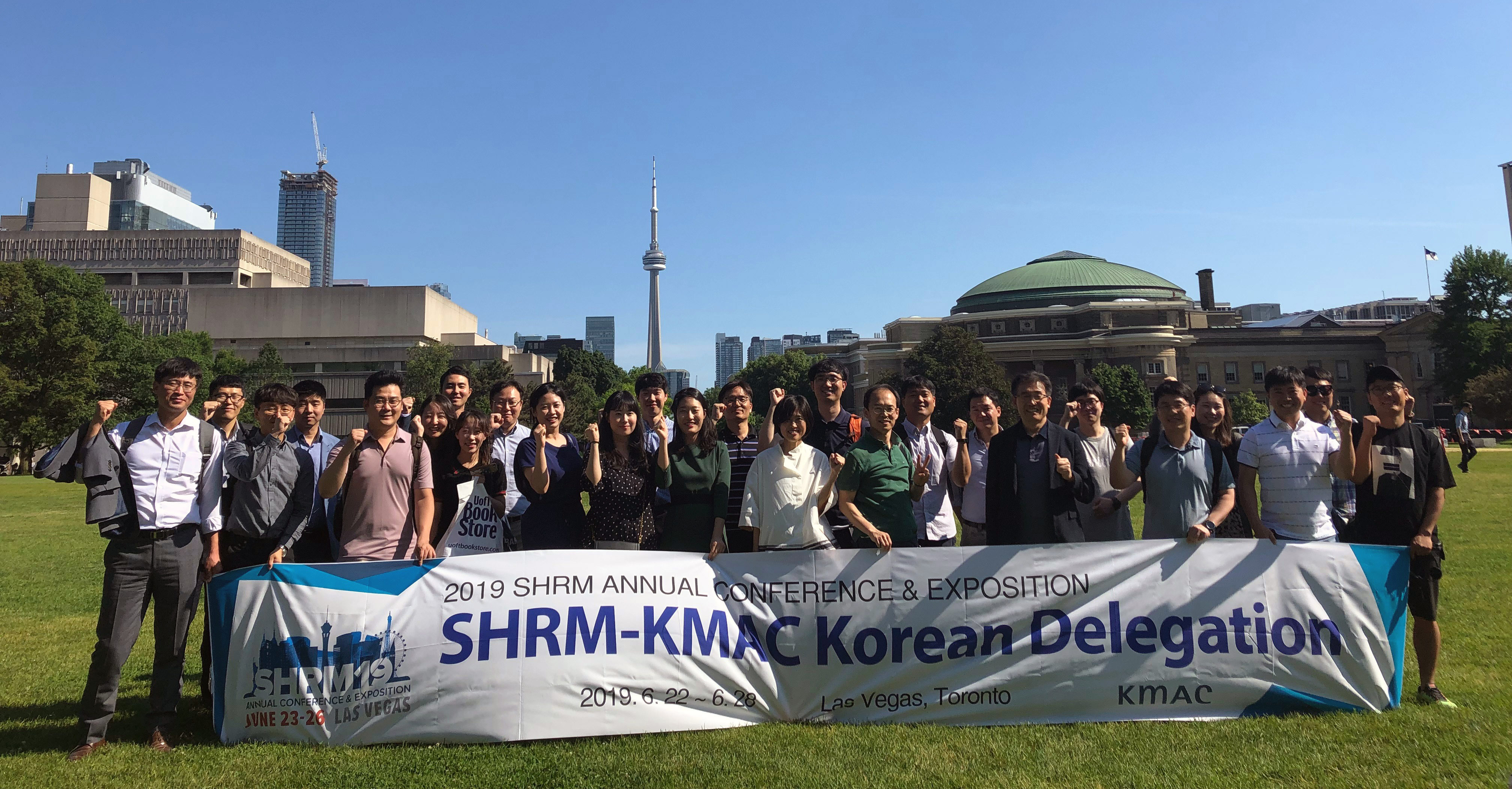The Korean delegation poses on U of T's Front Campus