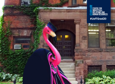 CIRHR house with a flamingo in a convocation gown and hood